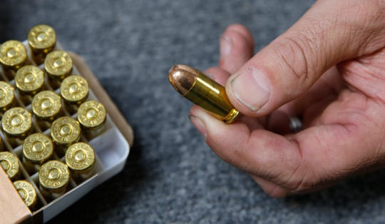 In this photo taken June 11, Chris Puehse, owner of Foothill Ammo displays a .45 caliber bullet for sell at his store in the Caifornia community of Shingle Springs. Californians will have to undergo criminal background checks every time they buy ammunition starting July 1 under a 2016 voter-approved ballot initiative.