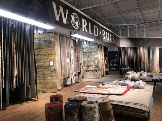 The rug section of the HOM Furniture in the Wausau Center mall is stocked with 600-800 rugs for its opening day. Rugs are sourced from around the world and in some cases, are handmade.