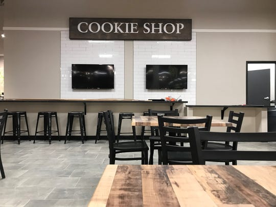 A cookie shop with a bar and tables in the new HOM Furniture store in the Wausau Center mall offers complimentary cookies made fresh on site, and beverages.