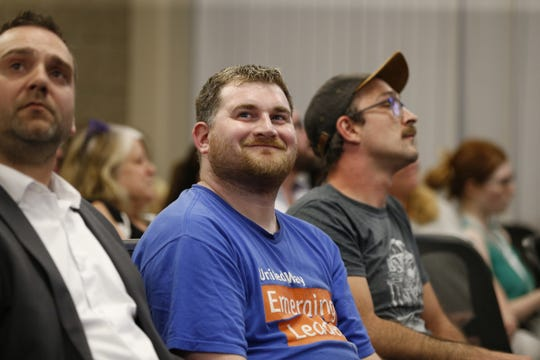 Matt Waltzman, 29, of Wausau, middle, reacts after the voting result from the Marathon County Board members Tuesday, June 25, 2019, during the Marathon County Board meeting at the Marathon County Courthouse in Wausau, Wis. On Waltzman's right is Marathon County's Deputy Corporation Counsel Lance Leonhard. T'xer Zhon Kha/USA TODAY NETWORK-Wisconsin