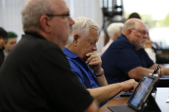 The Marathon County Board members make a vote on a motion Tuesday, June 25, 2019, during the Marathon County Board meeting at the Marathon County Courthouse in Wausau, Wis. T'xer Zhon Kha/USA TODAY NETWORK-Wisconsin