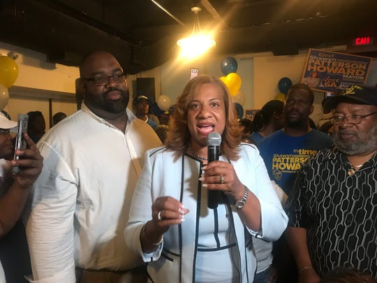 Shawyn Patterson-Howard with her husband, left, and other supporters at Luciadas restaurant in Mount Vernon on primary night as she leads the Democratic primary for mayor