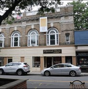 Joe Hazucha has hung a banner displaying the preamble of the US Constiution outside his Nyack office in apparent contravention of village law June 25, 2019.