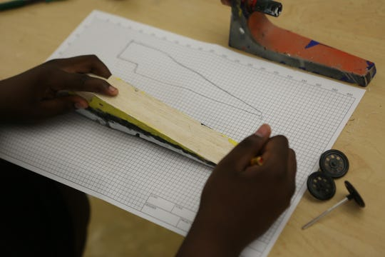 A students sketches out a dragster car for this weekend's National Technology Student Association Conference in Washington, D.C.
