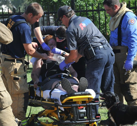 Wichita Falls emergency medical personnel prepare to transport a fire victim from the scene of a two-alarm house fire on Amber Lane, Wednesday morning.