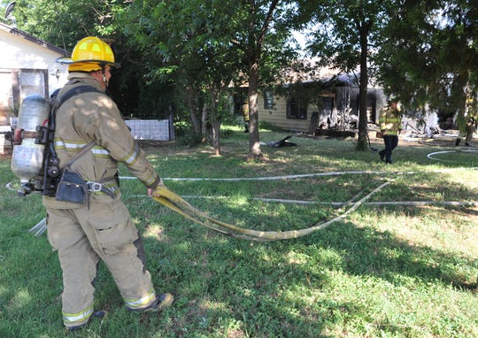 Wichita Falls firefighters battle to control a structure fire Wednesday morning at a house located in the 1100 block of Amber Avenue.