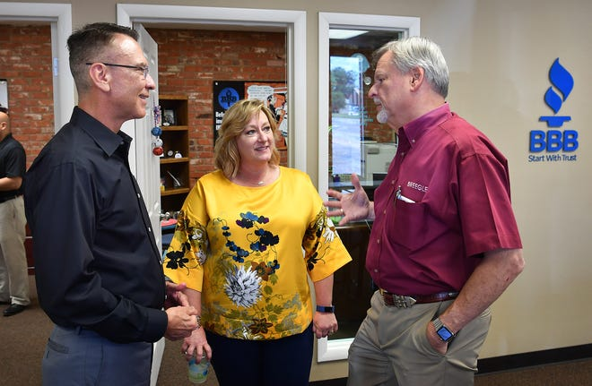 Better Business Bureau North Central Texas CEO Jay Newman, left, BBB president Monica Horton and Bobby Diltz of Breegle Flooring, visit during a meet and greet with Newman who was in town from the Dallas office Wednesday.