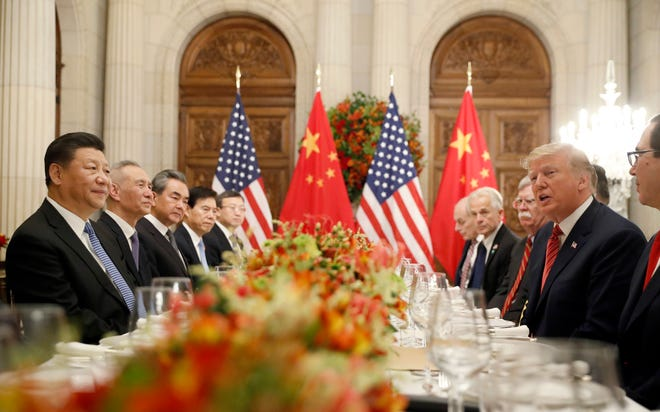 In this Dec. 1, 2018, file photo President Donald Trump speaks as China's President Xi Jinping listens during their bilateral meeting at the G20 Summit in Buenos Aires, Argentina. Trump meets with President Xi Jinping at the G-20 meeting in Japan this week.
