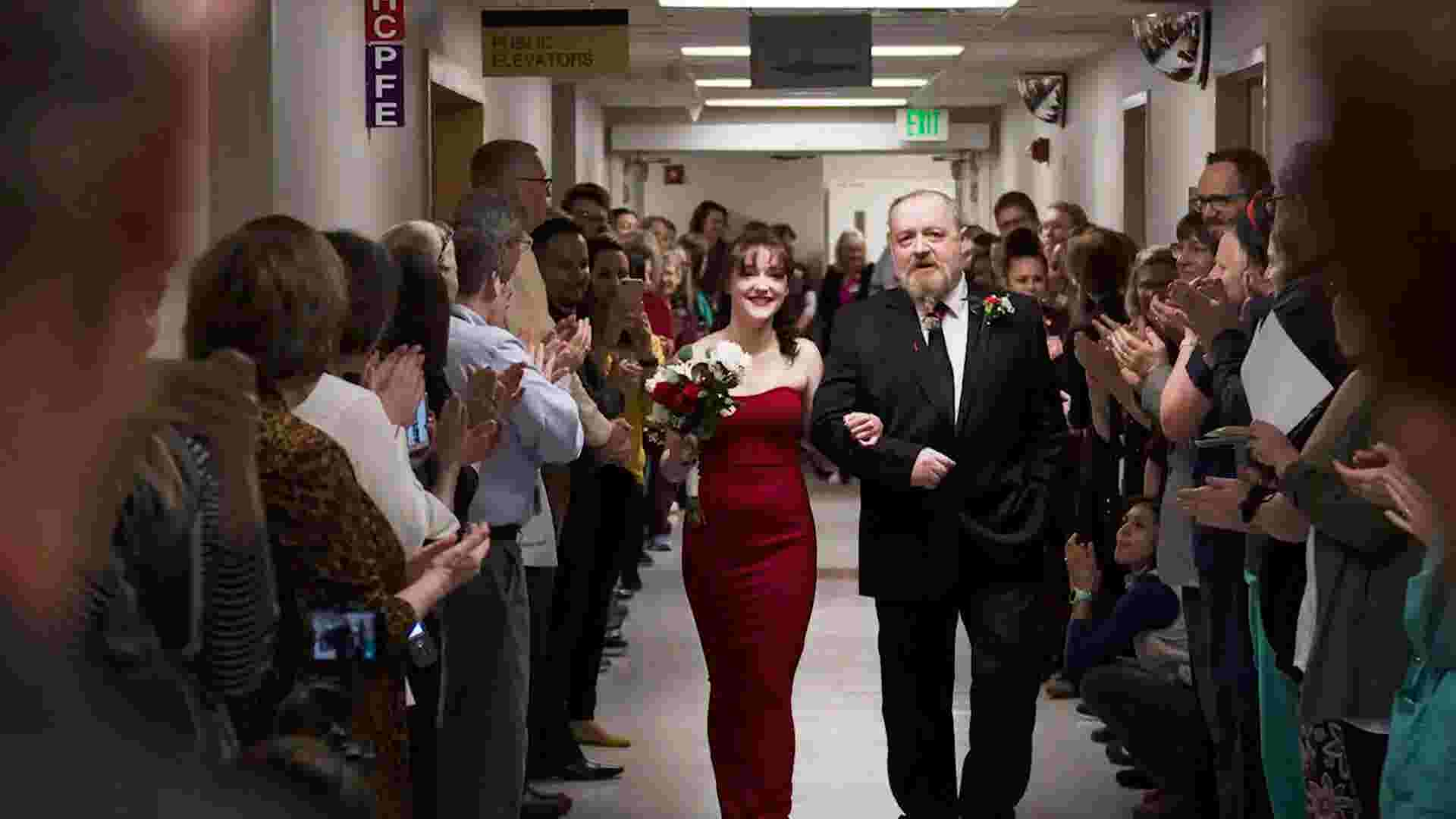 On wedding day, dad walks daughter down the hospital aisle