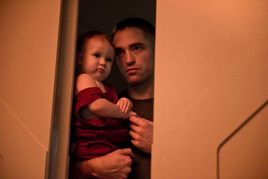 "Robert Pattinson stars as a man alone in space and raising a baby in the sci-fi film ""High Life."""
