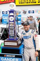 Ross Chastain celebrated with the winner's trophy at Iowa Speedway before NASCAR stripped him of the victory.