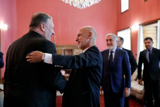 Secretary of State Mike Pompeo, left, is greeted by Afghan President Ashraf Ghani at the Presidential Palace in Kabul on June 25, 2019, during an unannounced visit. At right is Afghan Chief Executive Officer Abdullah Abdullah.