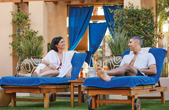 A couple settles in under a shaded cabana next to the Oasis Pool at Hyatt Regency Indian Wells Resort & Spa in Greater Palm Springs.