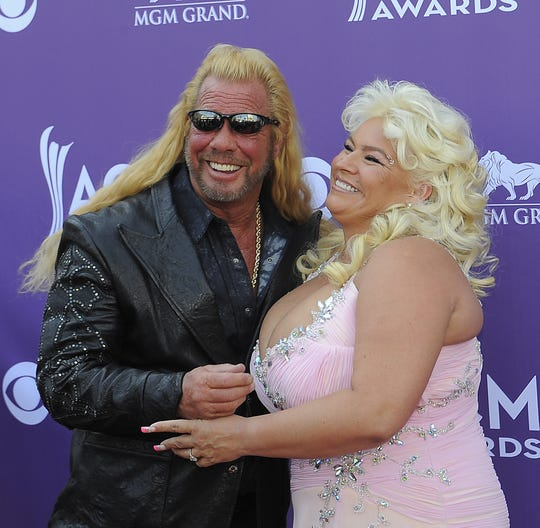 "Duane ""Dog"" Chapman and wife Beth Chapman walk the red carpet at the 48th annual Academy of Country Music Awards at the MGM Grand Garden Arena in Las Vegas in 2013."
