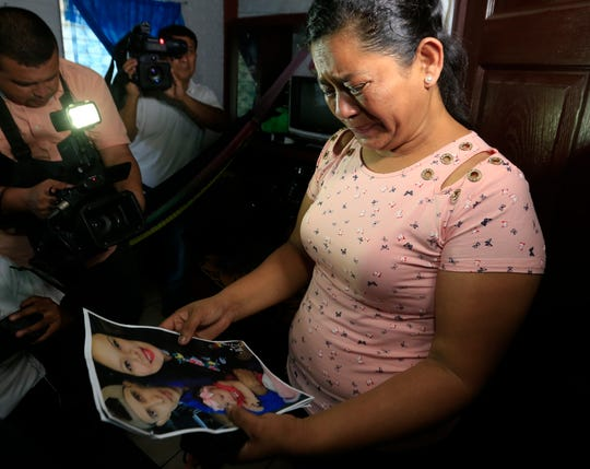 Rosa Ramirez cries when shown a photograph printed from social media of her son Oscar Alberto Martinez Ramírez, 25, granddaughter Valeria, nearly 2, and her daughter-in-law Tania Vanessa Avalos, 21, while speaking to journalists at her home in San Martin, El Salvador, on June 25. Her daughter-in-law survived.