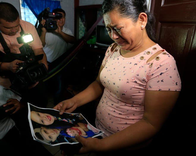 Rosa Ramirez cries when shown a photograph printed from social media of her son Oscar Alberto Martinez Ramírez, 25, granddaughter Valeria, nearly 2, and her daughter-in-law Tania Vanessa Avalos, 21, while speaking to journalists at her home in San Martin, El Salvador, Tuesday, June 25, 2019. The drowned bodies of her son and granddaughter were located Monday morning on the banks of the Rio Grande, a day after the pair were swept away by the current when the young family tried to cross the river to Brownsville, Texas. Her daughter-in-law survived. (AP Photo/Antonio Valladares) ORG XMIT: SLV101