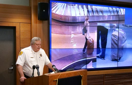Salt Lake City assistant Police Chief Tim Doubt releases video footage of a missing University of Utah student walking at the baggage claim at Salt Lake City International Airport, during a news conference Tuesday, June 25, 2019, in Salt Lake City.