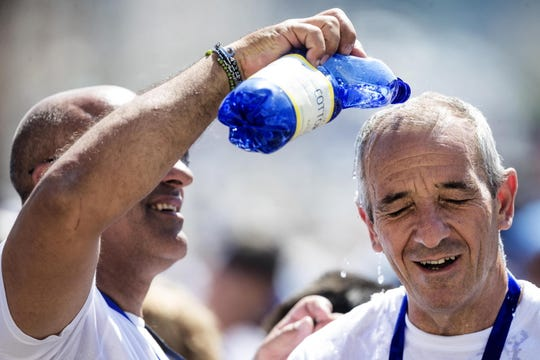 Faithful brave the heat to attend Pope Francis' weekly general audience in Saint Peter's Square, Vatican City, June 26, 2019.
