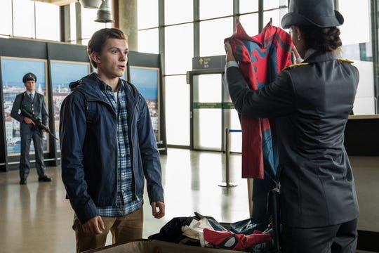 "Peter Parker (Tom Holland, left) is shocked to find his aunt packed his superhero suit when going through customs in ""Spider-Man: Far From Home."""