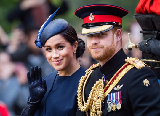 Prince Harry and Meghan Duchess of Sussex ride by carriage down the Mall during Trooping The Colour parade, on June 8, 2019 in London.