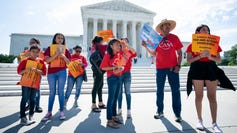 Protesters opposed to a citizenship question on the 2020 census demonstrated outside the Supreme Court Wednesday, a day before the justices are expected to rule in the case.