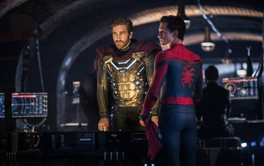 "Spider-Man (Tom Holland, right) makes a new superfriend in Mysterio (Jake Gyllenhaal) in ""Spider-Man: Far From Home."""