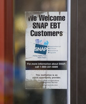 In this file photo, a food stamps/SNAP sign is seen in Baltimore. The Texas Health and Human Services Commission agreed Dec. 23 to pay $15,294,360 to the United States to settle a lawsuit claiming they violated the False Claims Act in its administration of the Supplemental Nutrition Assistance Program (SNAP).