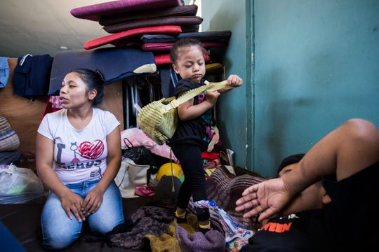 At left, Alba Macario, of Guatemala, and her two-year-old child Suriana get ready to begin their day at a shelter for migrants in Mexicali, Mexico. Macario claims that her child nearly died while they were in detention at a processing facility in Calexico, California, in May 2019. Macario and her two daughters are currently living in a shelter in Mexicali after being returned under the Migrant Protection Protocols policy.