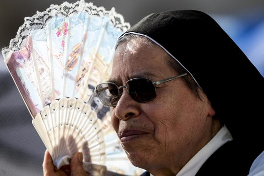 A nun braves the heat to attend Pope Francis' weekly general audience in Saint Peter's Square, Vatican City on June 26, 2019.