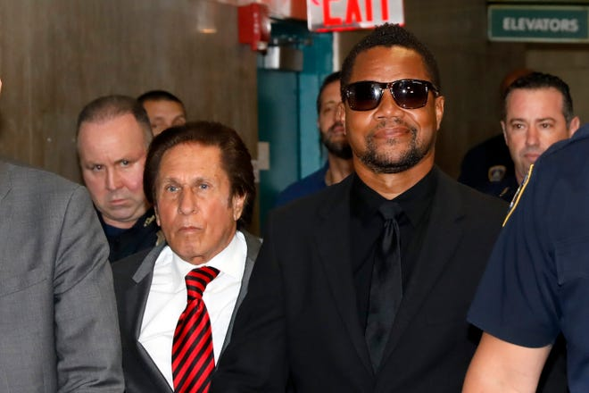 Cuba Gooding Jr., right, with his attorney Mark Heller, arrives at court in New York, June 26, 2019.