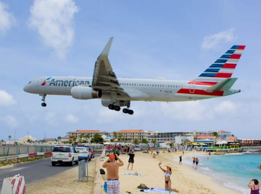 Plane spotting at Maho Beach is as popular tourist activity.