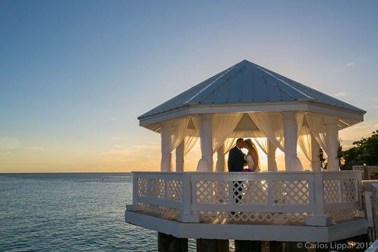 A couple ties the knot at the Sonesta Ocean Point Resort.