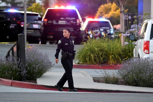 Police investigate at the scene of a shooting at the Morgan Hill Ford Store in Morgan Hill, Calif., Tuesday, June 25, 2019. Police say the shooting has killed at least two people in what may be a workplace confrontation.