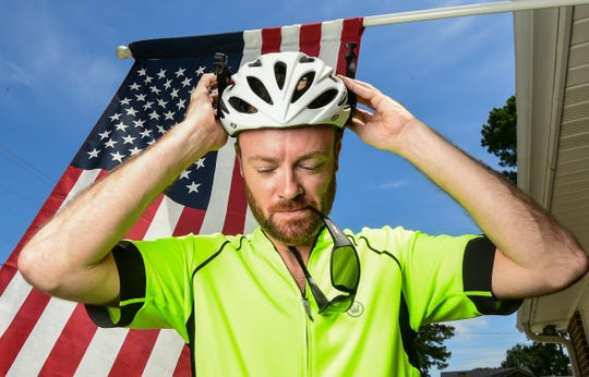 Jake Hollingsworth puts on his helmet for an afternoon ride, preparing for bike ride more than 400 miles across South Carolina to benefit homeless students in Anderson District 5 schools.