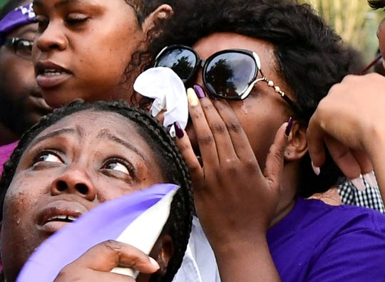 Marshella Rice, right, mother of Ja'Naiya Scott, cries with family as people release purple balloons for her daughter during a vigil Wednesday at Linley Park Wednesday, June 26, 2019. Ja'Naiya Scott, 11, died after someone fired more than 35 shots toward her home in Anderson, police said.