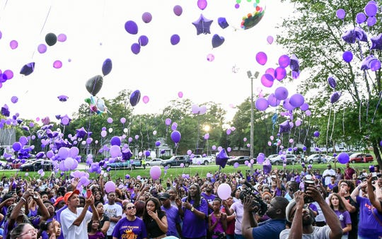 """Marshella Rice, mother of Ja'Naiya Scott, says """"Justice for Ja'Naiya"""" to release purple balloons for her daughter during a vigil Wednesday at Linley Park Wednesday, June 26, 2019. Ja'Naiya Scott, 11, died after someone fired more than 35 shots toward her home in Anderson, police said."""