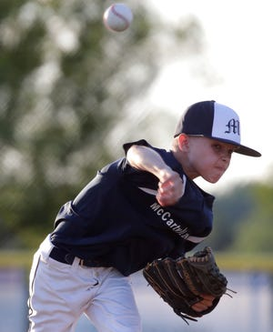 McCarty Law's Cade Prestigiacomo pitches against Appleton Firefighters during their Appleton Little League Baseball championship game on June 26, 2019, in Appleton. Appleton Little League is hoping there will be baseball this summer.