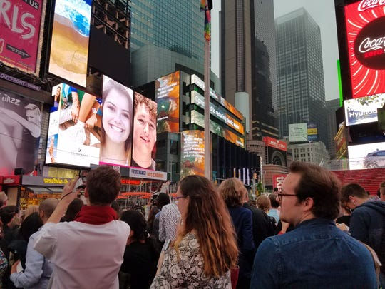 The headshot of recent Little Chute grad Kyra Hietpas appears on a billboard in Times Square on June 19 in New York City.