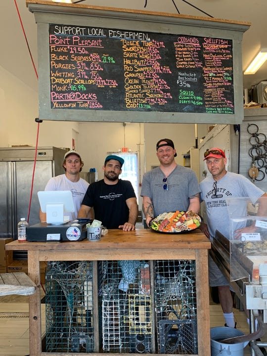 At Local 130 Seafood in Asbury Park, retail associate Billy Flood (from left), business partner Michael Kenlay, founder Eric Morris, and sushi chef Rham Fenton.