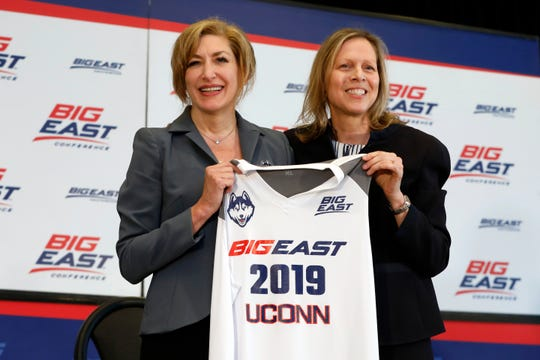Susan Herbst, left, President, University of Connecticut, and Big East Commissioner Val Ackerman, pose for photos at the announcement that the University of Connecticut is re-joining the Big East Conference, at New York's Madison Square Garden, Thursday, June 27, 2019.  (AP Photo/Richard Drew)
