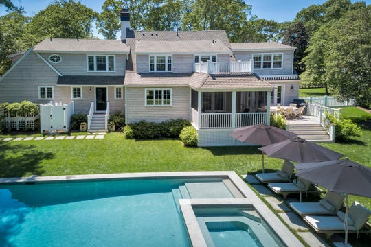 The backyard paradise offers a deck with a beautiful gunite pool and landscaped grounds