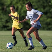 Manasquan, in grey, vs St. Rose, in yellow, battle in a game of the High School Girls Soccer League at Wall High School Sports Complex. Wall Township, NJWednesday, June 26, 2019