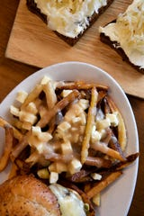 The poutine at Sawhorse is hand-cut french fries smothered in homemade cheddar curds and gravy.