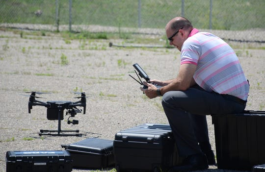 Corporal Andrew Olsen prepares to launch a drone also used to map crime scenes and crashes.
