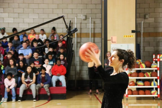 Musician Bess Greenberg demonstrated how she uses the rhythm of basketball to make music during Johnson City Elementary School's World of Possibilities Day on June 14.