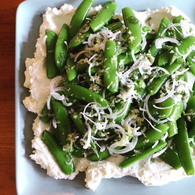 Ricotta serves as the perfect bed for crunchy fresh snap peas.