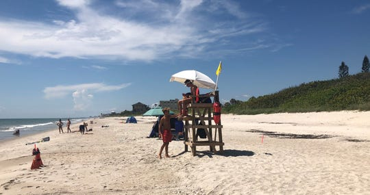 Lifeguards on duty at Pelican Beach just one day after a spotting of a supposed lemon shark in the area.