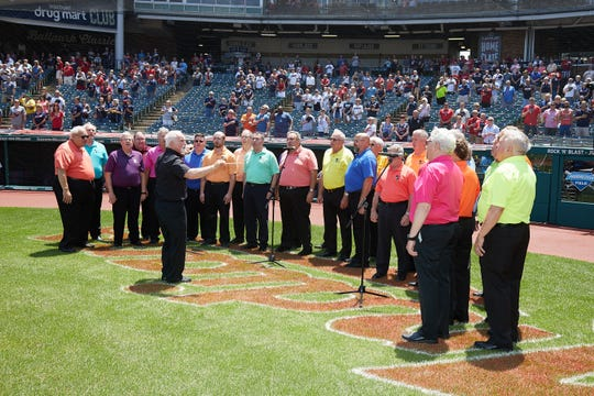 Under the direction of George Gibbs, members of Bucyrus-area mens' chorus United in Harmony perform the national anthem prior to the Cleveland Indians' game Wednesday at Progressive Field.