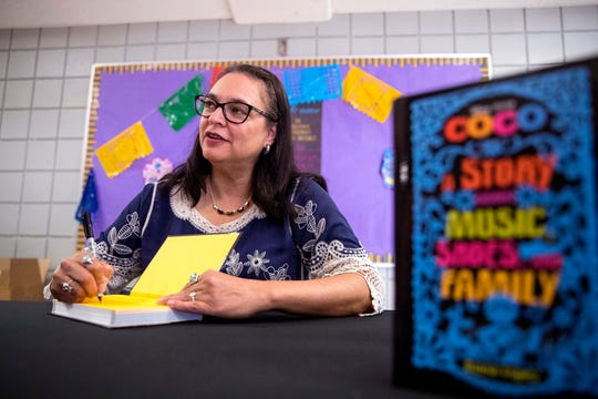 """Coco"" author, Diana Lopez, signs books following a presentation on Thursday, June 27, 2019. Students in the Robstown Independent School District's Summer School Academy  heard from Lopez about her experience as a writer and also the importance of reading."