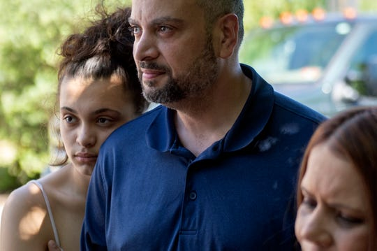 Cierrah Pagan, 16, from left, stands with her father Sergio Pagan and mother Michelle Pagan as they meet with Respond Inc. to discuss temporary housing in Camden, N.J. Thursday, June 27, 2019. The Pagan family lost their home to a fire the day before and are currently staying in a nearby motel.